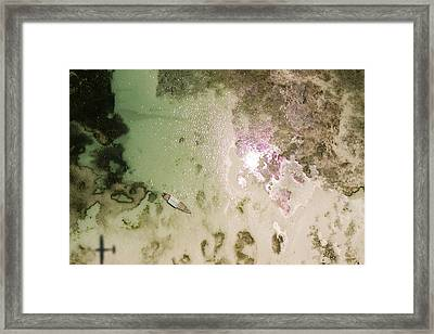 A Motor Boat Anchored In The Shallow Framed Print by Michael Fay