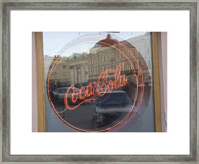 A Neon Coca Cola Sign Is Displayed Framed Print by Richard Nowitz