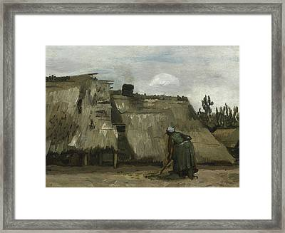 A Peasant Woman Digging In Front Of Her Cottage Framed Print by Vincent Van Gogh