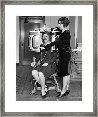 A Skin Peeling Treatment Framed Print by Underwood Archives