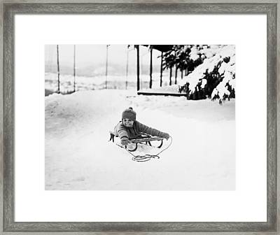 A Small Child On A Sled  Framed Print by American School