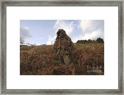 A Sniper Dressed In A Ghillie Suit Framed Print by Andrew Chittock