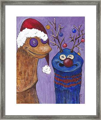A Sock Puppet Christmas Framed Print by Robin Wiesneth