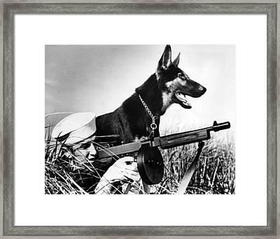 A Trained German Shepherd Sitting Watch Framed Print by Everett