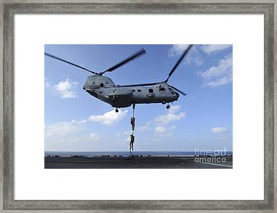 A Trio Of Marines Fast Rope Framed Print by Stocktrek Images