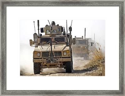 A U.s. Army M-atv Leads A Convoy Framed Print by Stocktrek Images