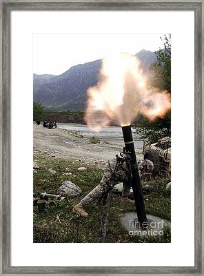 A U.s. Army Soldier Ducking Away Framed Print by Stocktrek Images