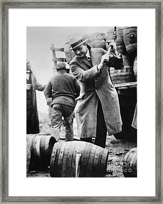 A Us Federal Agent Broaching A Beer Barrel From An Illegal Cargo During The American Prohibition Era Framed Print by American School