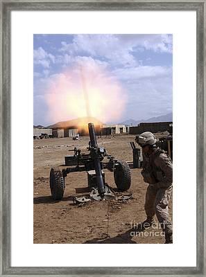 A U.s. Marine Corps Gunner Fires Framed Print by Stocktrek Images
