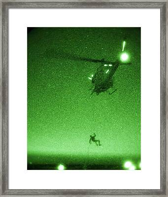 A U.s. Marine Rappels From A Uh-1n Huey Helicopter Framed Print by Celestial Images