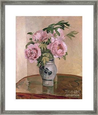 A Vase Of Peonies Framed Print by Camille Pissarro