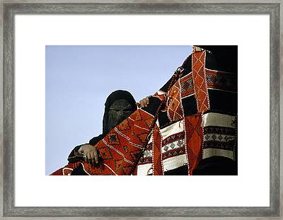 A Veiled Bedouin Woman Peers Framed Print by Thomas J. Abercrombie