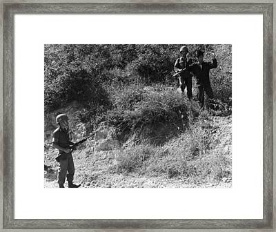 A Viet Cong Surrenders Framed Print by Underwood Archives