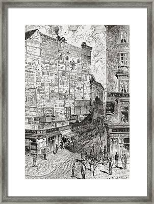 A Wall Of Advertisements On A Street In Framed Print by Vintage Design Pics