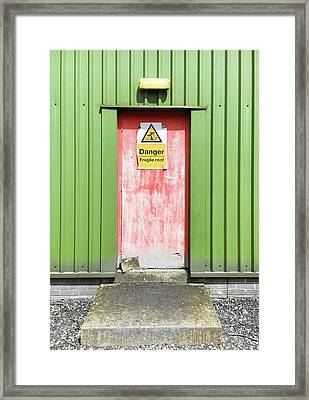 A Warehouse Exterior Framed Print by Tom Gowanlock