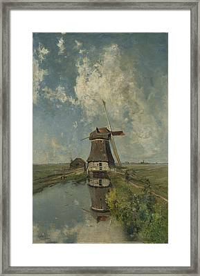 A Windmill On A Polder Waterway Framed Print by Celestial Images