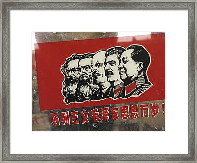 A Window Decal Of Communist Leaders Framed Print by Richard Nowitz