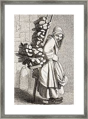 A Woman Carrying Firewood To Sell In Framed Print by Vintage Design Pics