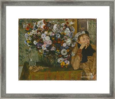 A Woman Seated Beside A Vase Of Flowers Framed Print by Celestial Images
