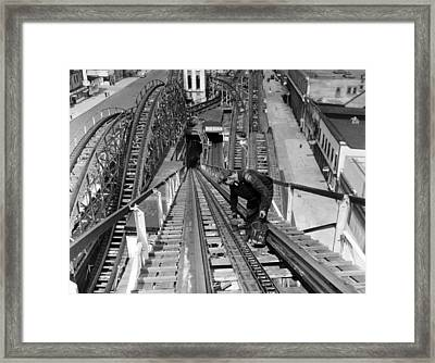 A Workman Greases Up The Tracks Framed Print by Everett