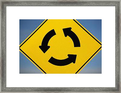 A Yellow Sign Showing Three Arrows Framed Print by Michael Interisano