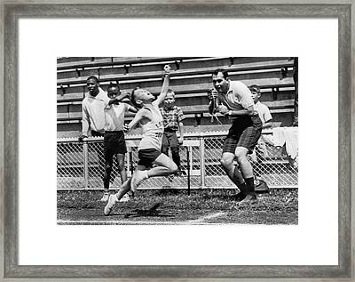 A Young Athlete Sprinting Framed Print by Underwood Archives