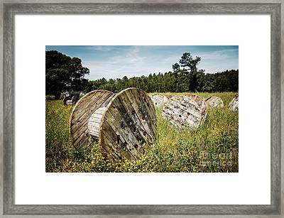 Abandoned Cable Reels Framed Print by Carlos Caetano
