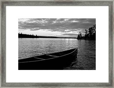 Abandoned Canoe Floating On Water Framed Print by Keith Levit