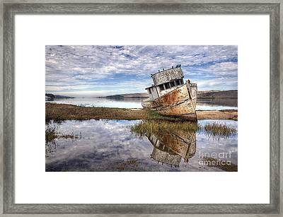 Abandoned Ship Framed Print by Eddie Yerkish