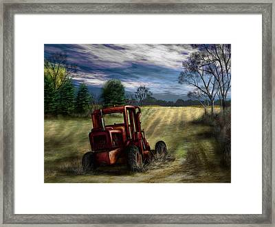 Abandoned Tractor Framed Print by Ron Grafe