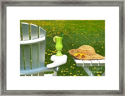 Adirondack Chair On The Grass  Framed Print by Sandra Cunningham