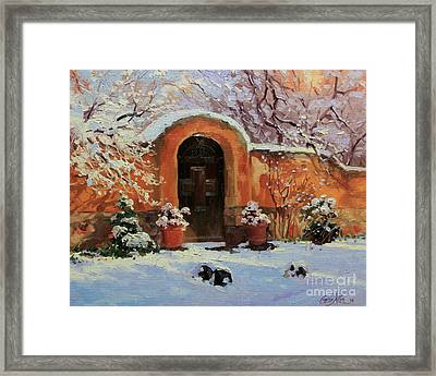 Adobe Wall With Wooden Door In Snow. Framed Print by Gary Kim