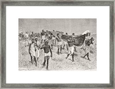 African Porters Carrying Henry Morton Framed Print by Vintage Design Pics