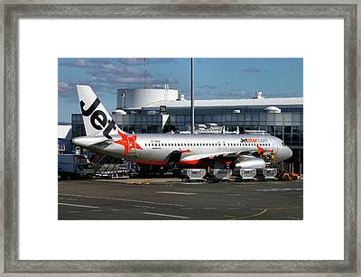 Airbus A320-232 Framed Print by Tim Beach