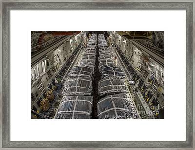 Airmen Prepare Pallets On A C-17 Framed Print by Stocktrek Images