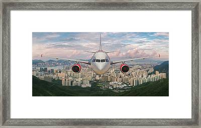 Airplane Over Hongkong Island Framed Print by Anek Suwannaphoom