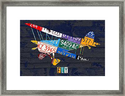 Airplane Vintage Biplane Silhouette Shape Recycled License Plate Art On Blue Barn Wood Framed Print by Design Turnpike