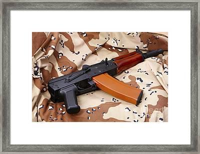Ak-47u On Old Persian Gulf War Desert Battle Dress Uniform Framed Print by Joe Fox