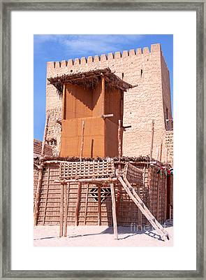 Al Manama Summer Bed And House With Cooling Tower Framed Print by Chris Smith