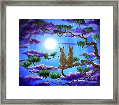 Alone In The Treetops Framed Print by Laura Iverson