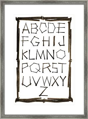 Alphabet Picture Made From Antique Rusty Nails Isolated On White Framed Print by Donald  Erickson