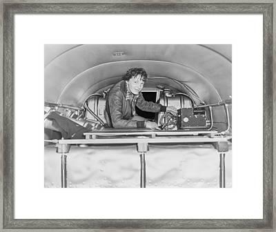 Amelia Earhart 1897-1937, Checking Framed Print by Everett