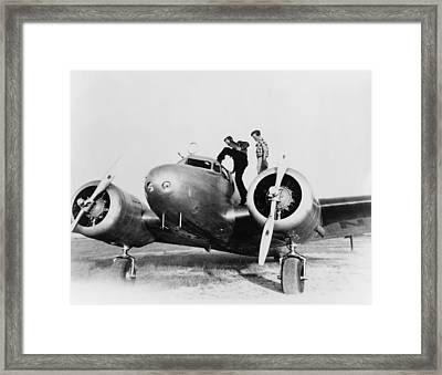 Amelia Earhart Stanind On The Wing Framed Print by Everett