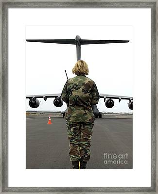 An Airfield Manager Greets An Arriving Framed Print by Stocktrek Images