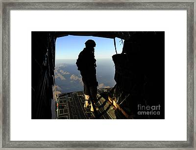 An Airman Inspecting Pallets Of Cargo Framed Print by Stocktrek Images