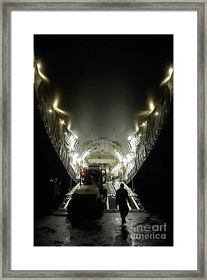 An Airman Uses A Forklift To Load Framed Print by Stocktrek Images