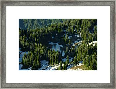 An Alpine Lake  Framed Print by Jeff Swan