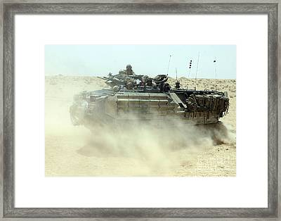 An Amphibious Assault Vehicle Kicks Framed Print by Stocktrek Images