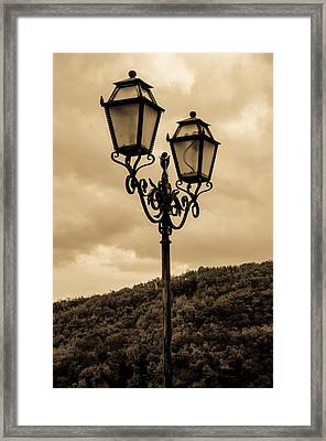 An Ancient Streetlight Framed Print by Andrea Mazzocchetti