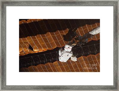 An Astronaut Anchored To A Foot Framed Print by Stocktrek Images